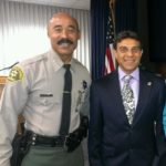 With Assistant Sheriff Cecil Rhambo